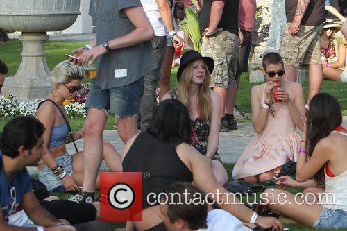 Pixie Geldof and Agyness Deyn sitting with friends...