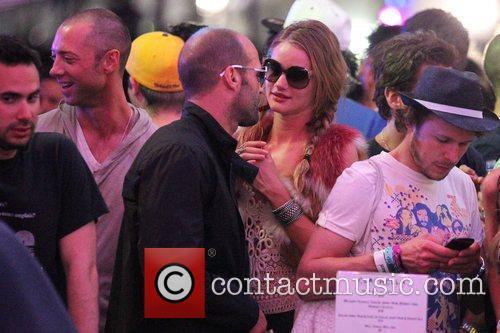 Jason Statham and Isabel Lucas talking at the...
