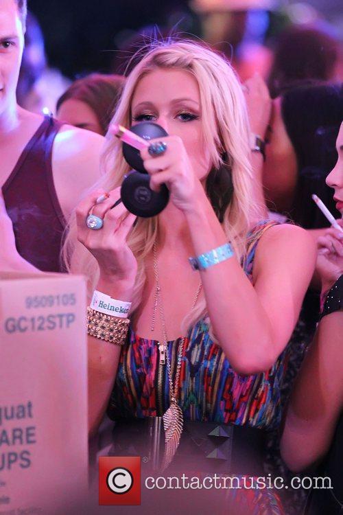 Paris Hilton smoking and applying make-up at the...