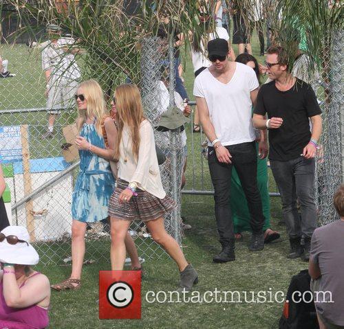 Alexander Skarsgard walking behind girlfriend Kate Bosworth at...