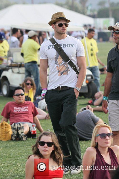 Kellan Lutz wearing a Playboy t-shirt at the...