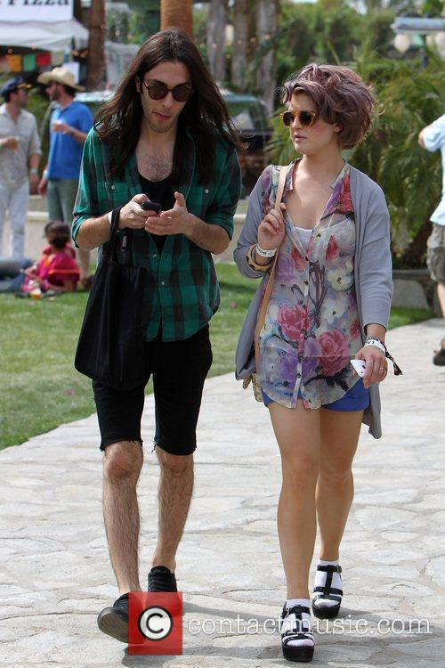 Kelly Osbourne walking with a friend at the...