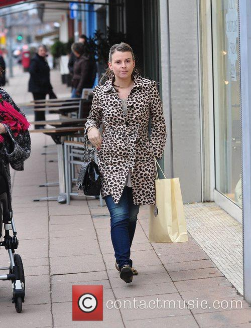 Coleen Rooney shopping with her parents and her...