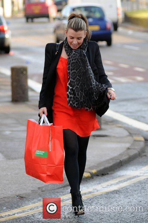 Coleen Rooney carrying a large bag after shopping...