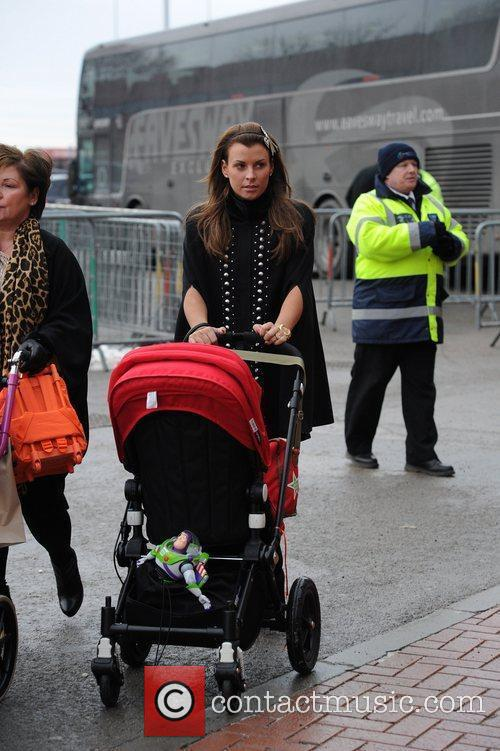Coleen Rooney arrives with her family at the...