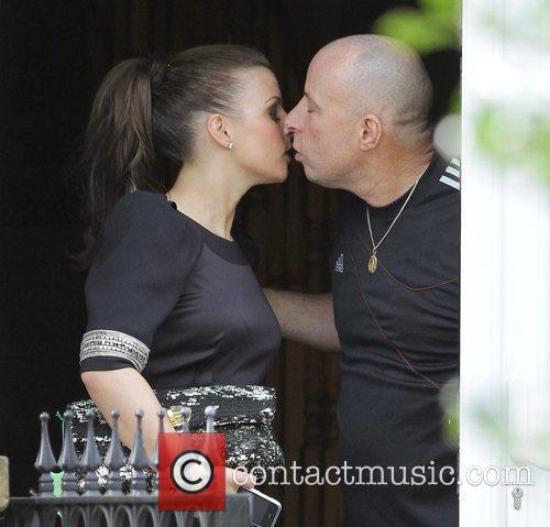 Coleen Rooney kisses her dad goodbye as she...