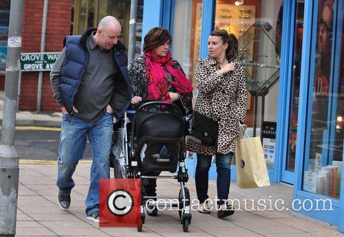 Shopping with her parents Colette and Tony McLoughlin...
