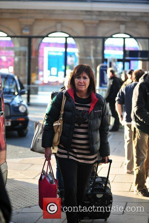 Coleen Rooney's mum arriving back in Liverpool after...