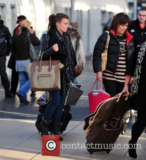 Coleen Rooney with her mum arriving back in...
