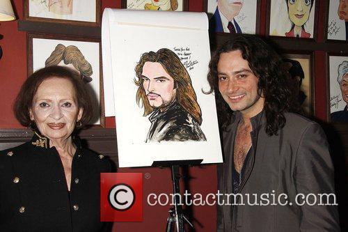 Constantine Maroulis receives his caricature at Sardi's