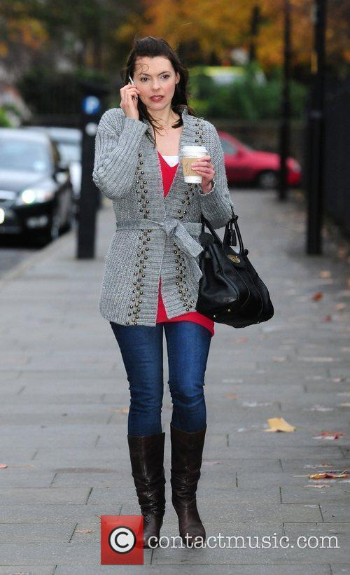 Kate Ford talking on her mobile phone at...