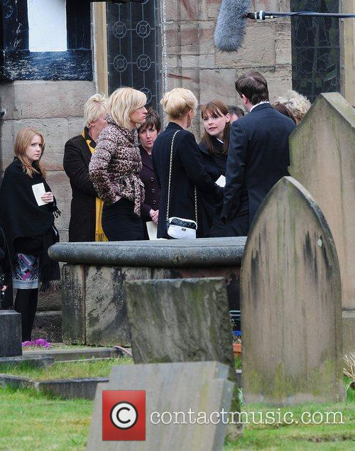 The cast of 'Coronation Street' filming the funeral...