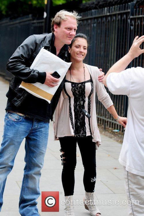 Antony Cotton posing for a photo with a...