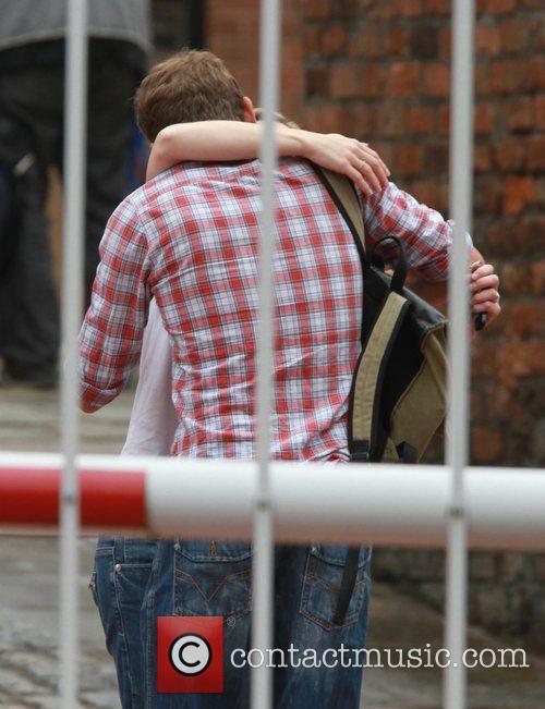 Jane Danson hugs a male companion 'Coronation Street'...