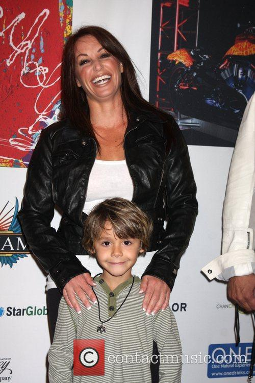 CC Perkinson with her son Harley Davidson showcase:...