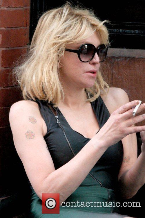 Courtney Love smoking a cigarette (or weed)