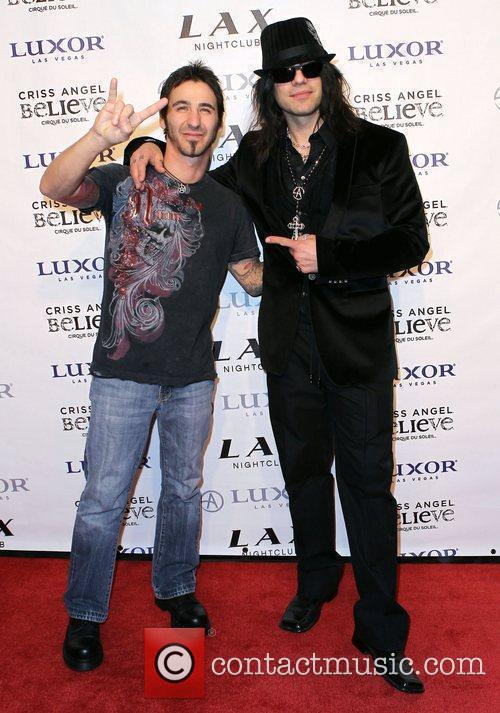 Micky James and Criss Angel Criss Angel celebrates...