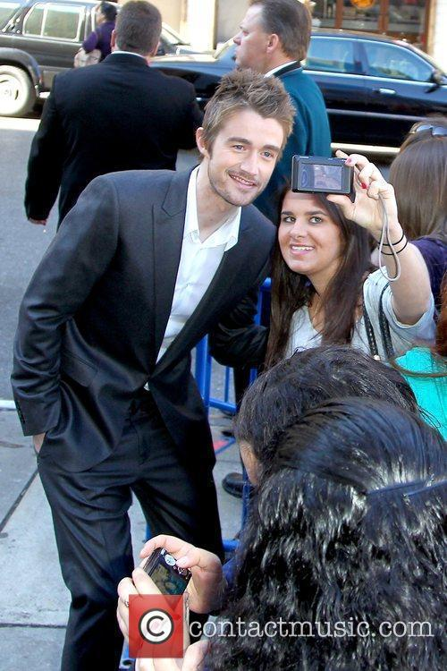 Robert Buckley posing with a fan 2010 The...