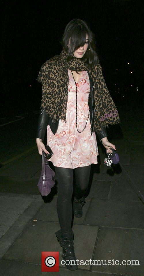 Daisy Lowe  takes a little dog for...