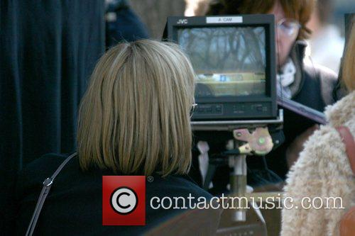 Abbie Cornish reviewing footage on the film set...