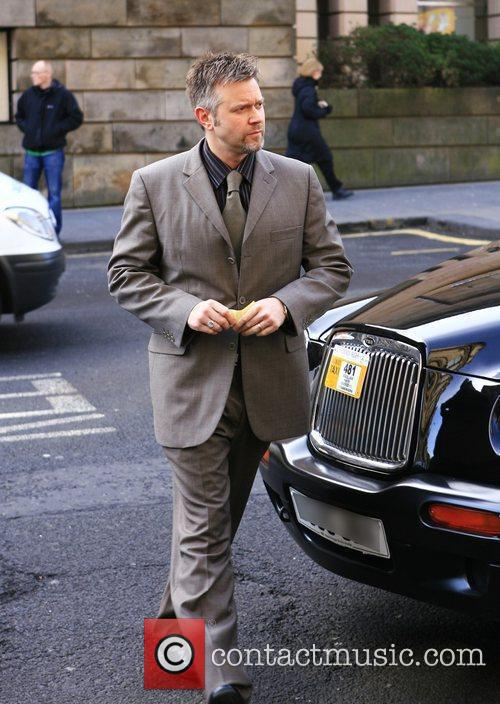 Darren Day arrives at court where he is...