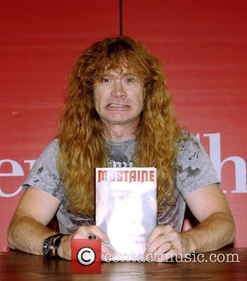 Dave Mustaine of Megadeth signs copies of his...