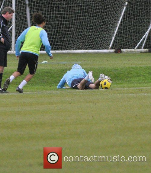 Takes part in a Tottenham Hotspur training session...