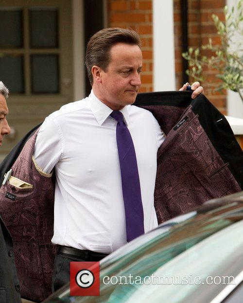 Prime Minister David Cameron leaving his house wearing...