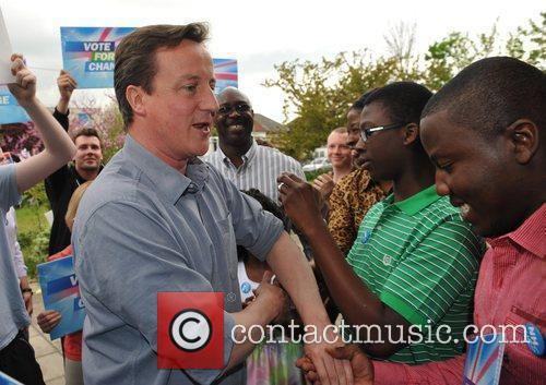David Cameron speaks to an audience as he...