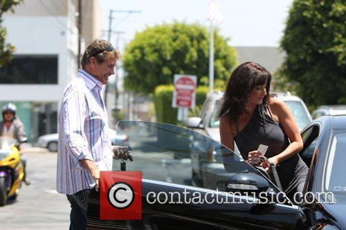 David hasselhoff and a female companion returning to...