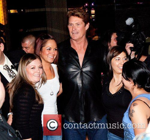David Hasselhoff poses for pictures with fans inside...