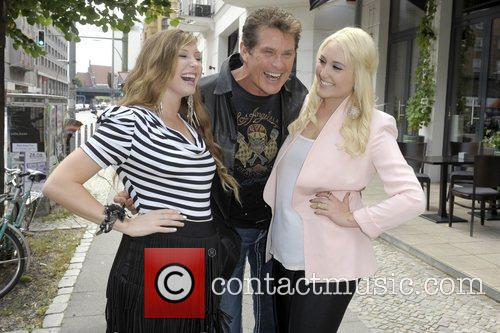 David Hasselhoff posing with his daughters at Lux...