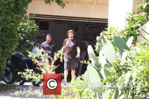 Outside his house in Encino after getting his...