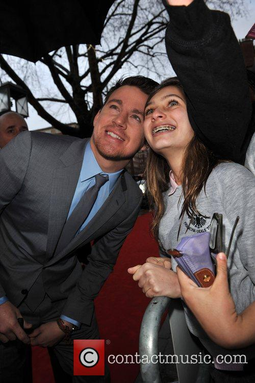 Channing Tatum takes a photo with a fan...