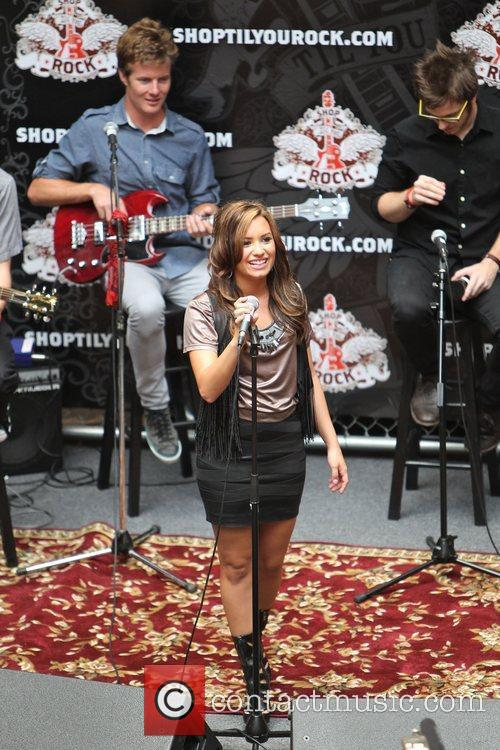 Demi Lovato performs live for fans at the...