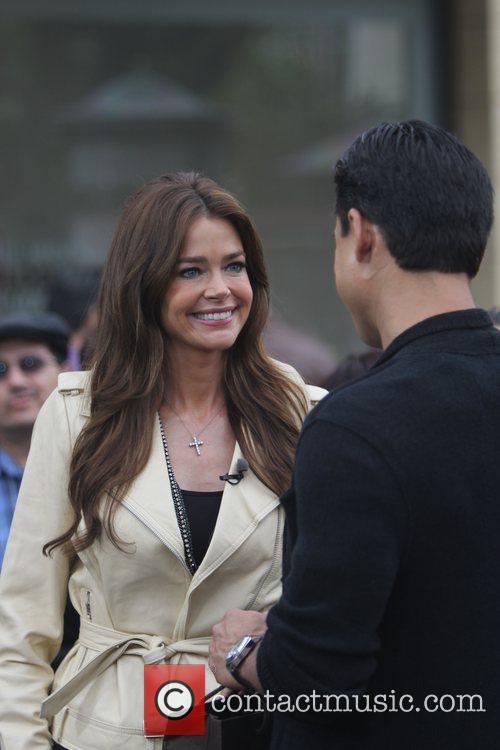 Denise Richards filming an interview with Mario Lopez...