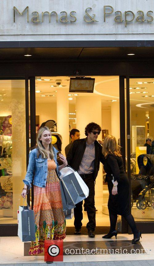 Lee Mead leaves Mamas & Papas carrying a...