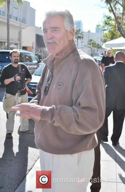 Actor Dennis Farina leaves a restaurant after having...