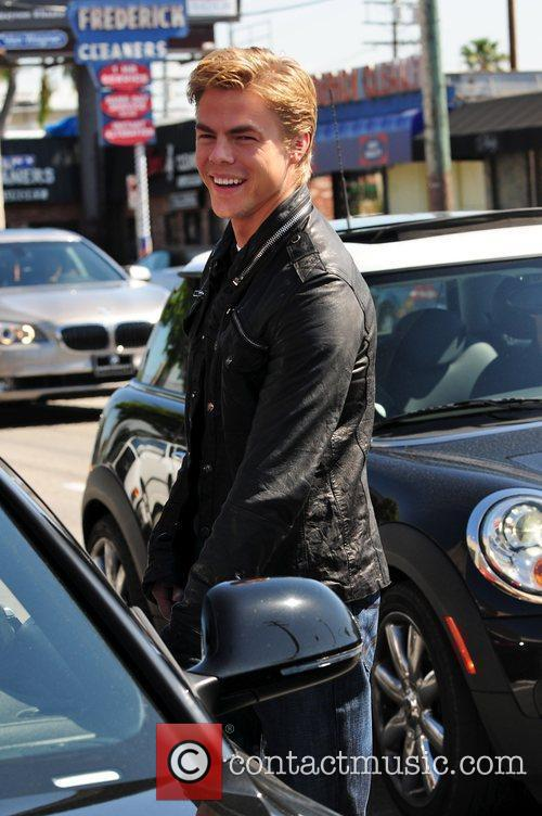Derek Hough departs Toast after having lunch with...
