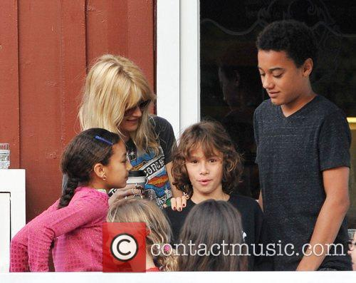 Actress, Laura Dern and her children enjoy a...