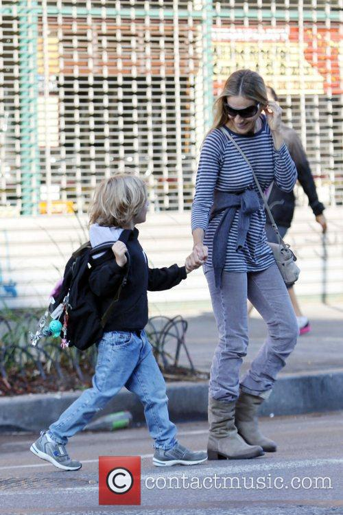 Walks with her son James Wilkie Broderick to...