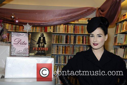 Dita Von Teese signs copies of her new...