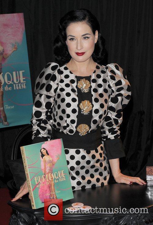 Dita Von Teese signs copies of her book...