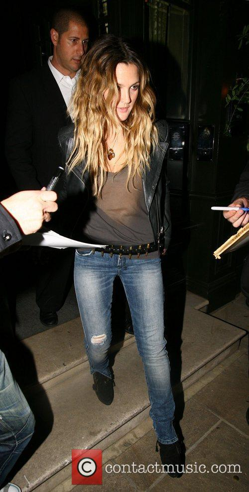 Drew Barrymore leaves her London hotel and heads...