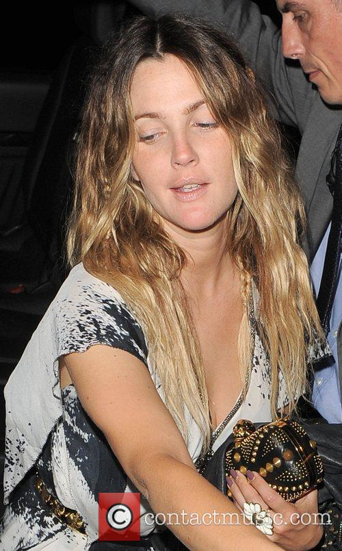 Drew Barrymore appears very tired as she arrives...