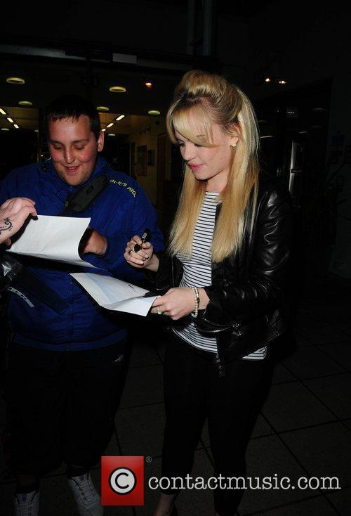 Duffy  signs autographs for fans as she...