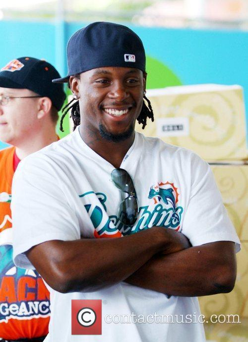 Davone Bess  Miami Dolphins football players distribute...