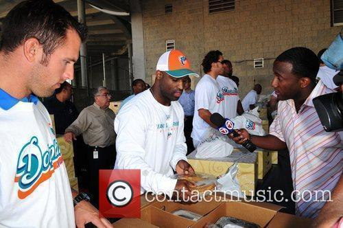 Tyler Thigpen and Ricky Williams Miami Dolphins football...