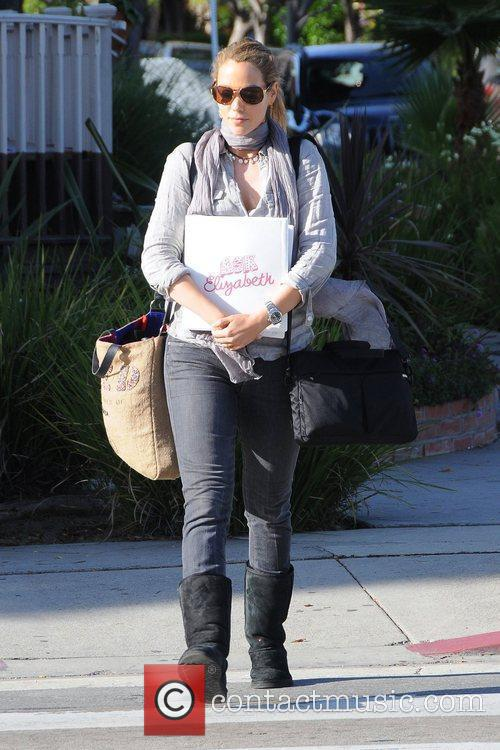 Arrives at a private residence in West Hollywood...
