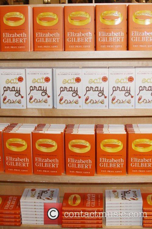 Elizabeth Gilbert author of 'Eat Pray Love' signs...